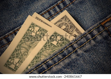 dollar bills sticking out of his jeans pocket, instagram image style - stock photo