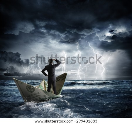 dollar boat in the bad weather  - stock photo