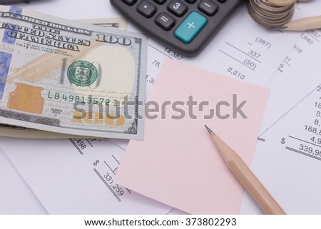 Dollar cash and calculator on business documents background - stock photo