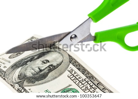 dollar currency notes and scissors - stock photo
