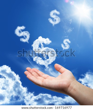 Dollar dreaming - hand in the sky  - stock photo