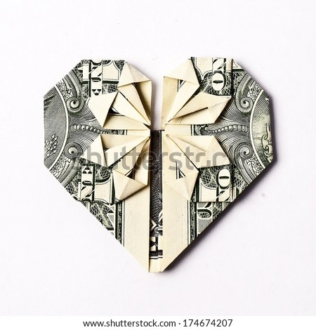 Dollar folded into heart on the white background  - stock photo