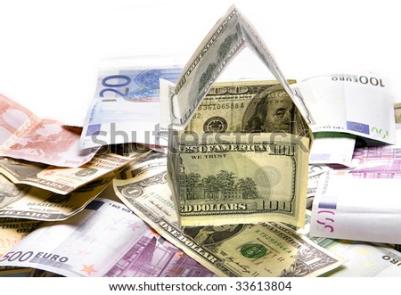 Dollar house in pile of money isolated over white background - stock photo