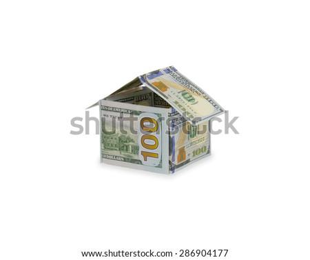 Dollar house isolated on white background close-up - stock photo