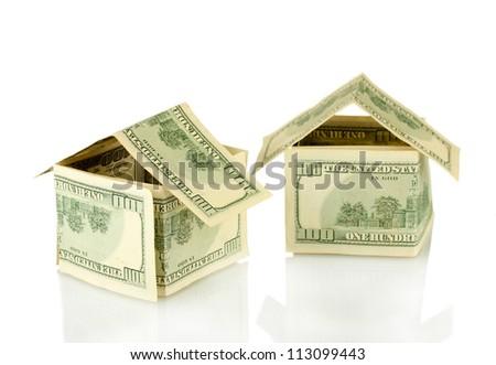 Dollar houses isolated on white background close-up - stock photo
