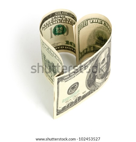 Dollar in form of heart - stock photo