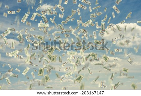 dollar note falling down over blue sky - stock photo