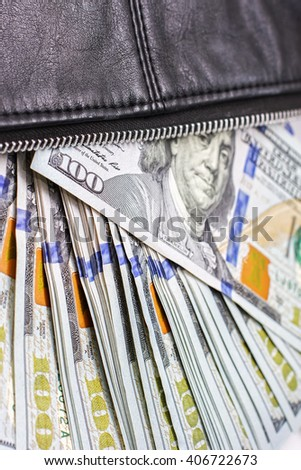 dollar notes in a wallet, hundred-dollar bills are in a bag, to spend money in your wallet close - stock photo