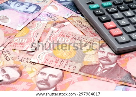 Dollar notes in New Zealand currency $100 $50 $20 and calculator - stock photo