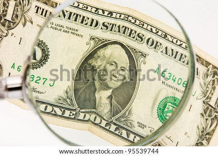 dollar photographed a magnifying glass, white background - stock photo
