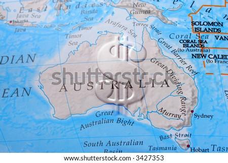 Dollar sign across Australia depicting economy, business, or commerce - stock photo