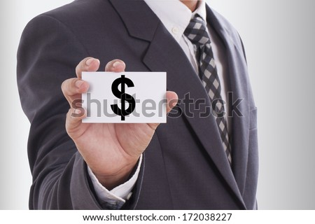 Dollar sign. Businessman in suit, shows business card.  - stock photo