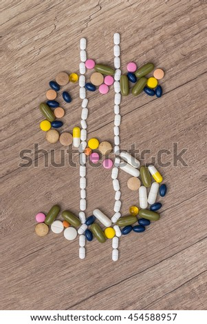 Dollar sign made with drug pills - stock photo