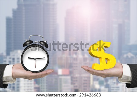 Dollar sign on one hand and alarm clock on another hand, with sunlight city background, concept of deal and time. - stock photo