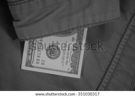 Dollar up his sleeve jacket - stock photo