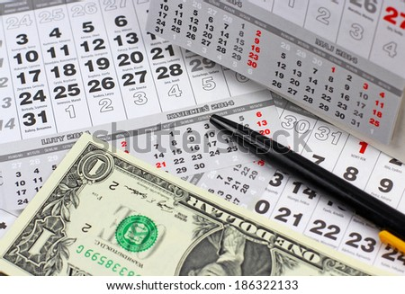 Dollars and calendar  - stock photo