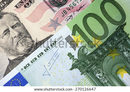 Dollars and Euro banknotes background - stock photo