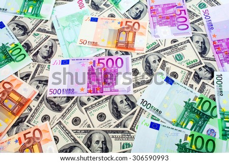 Dollars and Euro close up background - stock photo