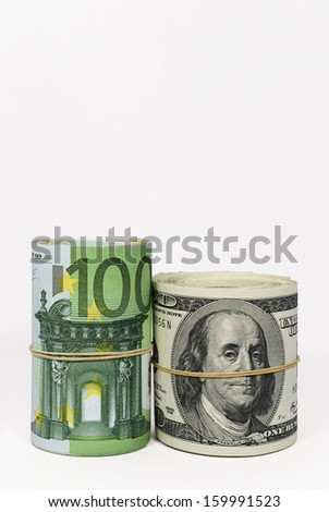 Dollars and Euros Note Rolls Photo (with clipping path) - stock photo