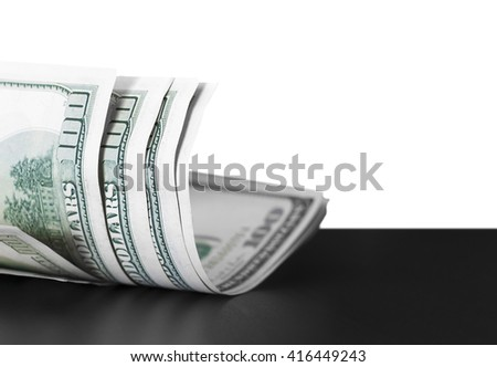 Dollars are loose randomly on the black table - stock photo
