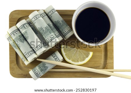 Dollars are served as rolls with soy sauce, lemon and chopsticks,isolated on white background,top view - stock photo