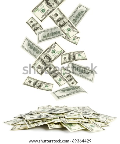 Dollars falling to the stack of dollars - stock photo