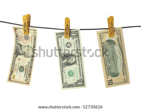 Dollars hang on clothes-peg - stock photo