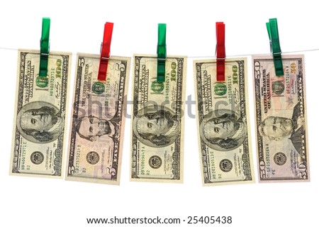 Dollars hanging on red and green clotheslines isolated on white background - stock photo