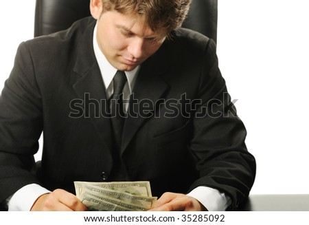 Dollars in a hands of the businessman - stock photo