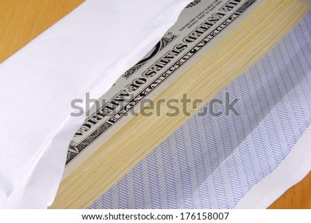 Dollars in an envelope - stock photo
