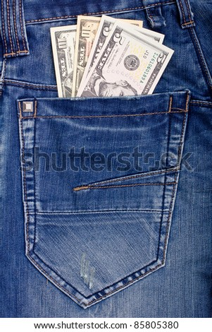 Dollars in blue jeans back pocket - stock photo