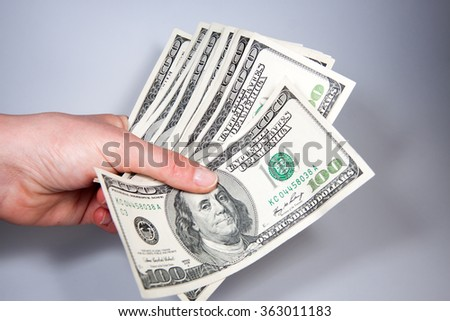 Dollars in denominations of 100 - stock photo