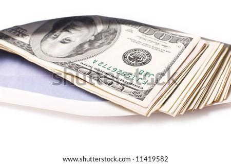 Dollars in envelope against white background. Shallow DOF. - stock photo