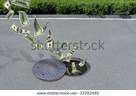 dollars in manhole - stock photo