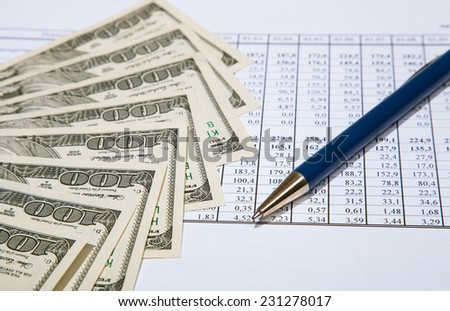 Dollars, pen and documents - closeup shot - stock photo
