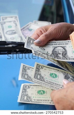 Dollars with car - stock photo