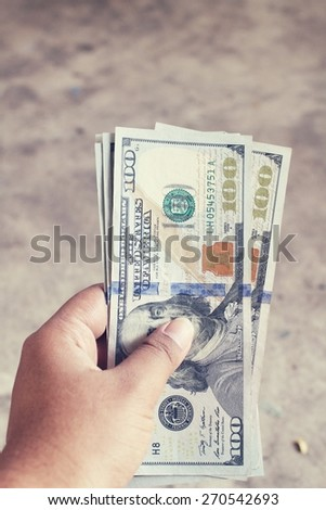 Dollars with hand - stock photo