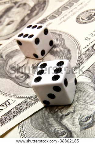 dollars with playing bones - stock photo