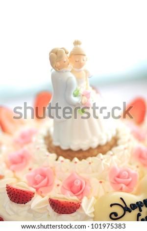 Dolls on the wedding cake - stock photo