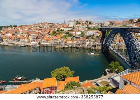 Dom Luis I bridge in Porto in Portugal in a summer day - stock photo
