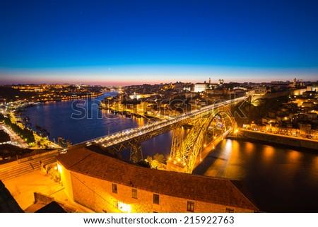 Dom Luiz bridge in Porto Portugal at dusk - stock photo