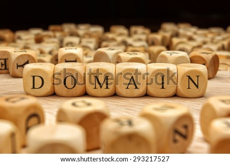 DOMAIN word written on wood block - stock photo