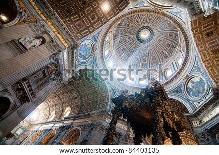 Dome in St. Peter's Basilica and Bernini's Baldacchino - stock photo