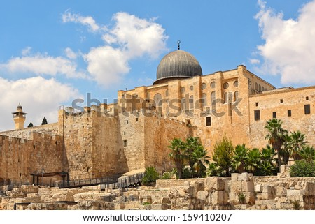 Dome of Al-Aqsa Mosque surrounded by walls and ancient ruins in Old City of Jerusalem, Israel. - stock photo