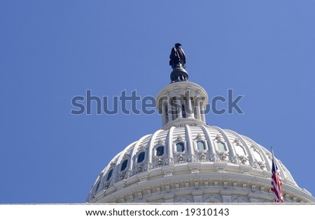Dome of capitol in Washington DC with flag - stock photo