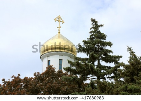 dome of orthodox church behind trees - stock photo