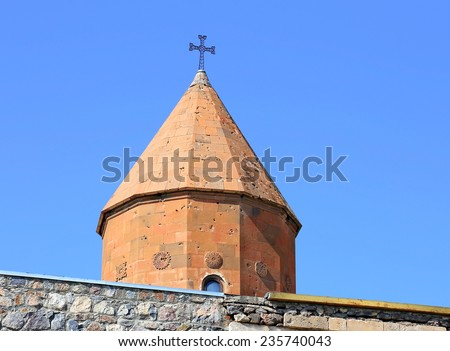 Dome of the ancient church on a background of blue sky - stock photo