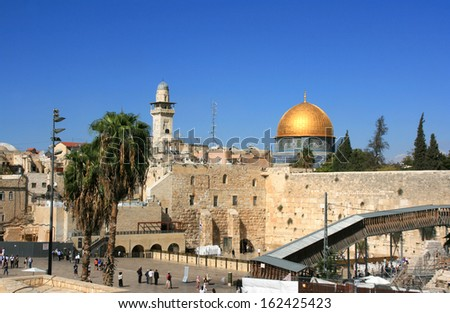 Dome of the Rock and the wailing wall in the Old city of Jerusalem - stock photo