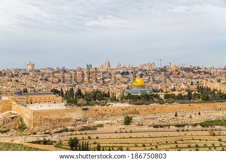 Dome of the Rock in beautiful panorama of Jerusalem from Mount of Olives. - stock photo