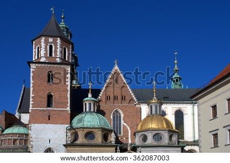 Domes and a tower of the cathedral on Wawel Hill in Krakow Poland. Poland's monarchs used to be crowned here. The chapel with the golden dome is Kaplica Zygmuntowska - stock photo